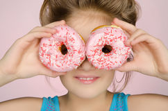Girl with two donuts Royalty Free Stock Photography