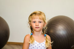 Girl with two fit balls Stock Photography