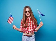 Girl and two flags on a stick Royalty Free Stock Images