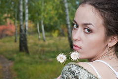 Girl with two flowers Stock Photography