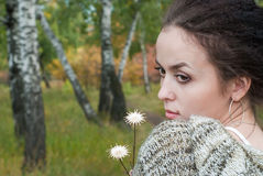 Girl with two flowers Stock Photo