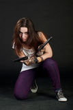 Girl with two guns Royalty Free Stock Photo