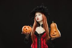 Girl with two Halloween pumpkin on black Royalty Free Stock Image