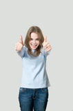 Girl two hand thumbs up Stock Photography