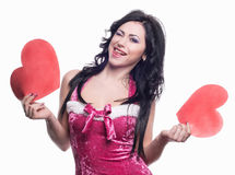 Girl and two hearts. Girl holding two hearts and winks Stock Images