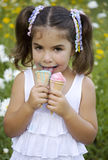Girl with two ice cream Royalty Free Stock Photo