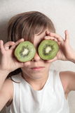 Girl with two Kiwis on the eyes Royalty Free Stock Image