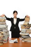 Girl and two large piles  books Stock Image