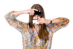 The girl with two mobile phones. Black and white phones. isolated over a white background Stock Images