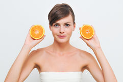 Girl with two oranges. Stock Images