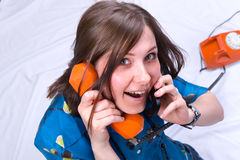 Girl on two phone red(orange) and black Stock Photo