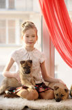Girl with two puppies Stock Photos