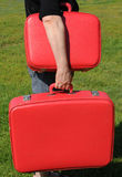 Girl with two red suitcases Stock Photos