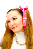 Girl with two tails and pink ribbons Stock Images