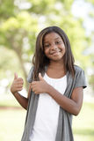 Girl with two thumbs-up. Image of a young child showing two thumbs-up Royalty Free Stock Photography