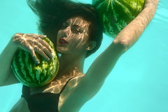 Girl with two watermelons Stock Photo