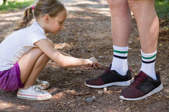 Girl tying her grandfathers shoe laces Royalty Free Stock Images