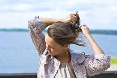 Girl tying her hair hairpins Stock Image