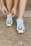 The Girl Tying Running Shoes. The Girl Tying Running Shoes Prior to exercise Royalty Free Stock Images