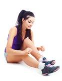 Girl tying shoelaces Stock Image