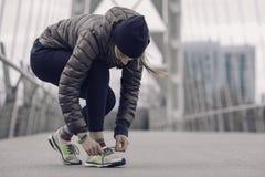 Girl tying shoelaces