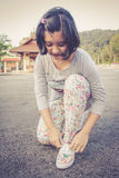 Girl tying shoes Stock Photo