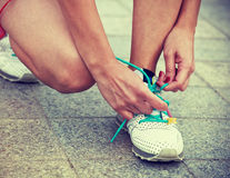 Girl tying shoes laces Stock Photo