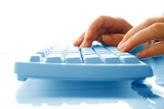 Girl typing. Girl hands typing on keyboard macro close up royalty free stock photography