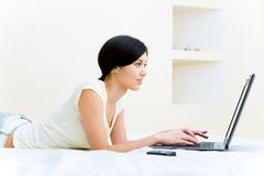 Girl typing Stock Images
