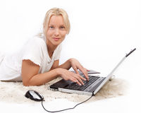 Girl typing on her latop Royalty Free Stock Image