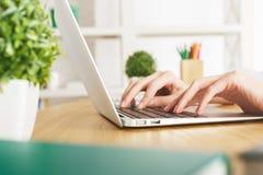 Girl typing on keyboard Stock Photo