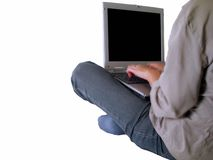 Girl typing on a laptop. Sitting on the floor-you can put what you need on the screen Royalty Free Stock Image