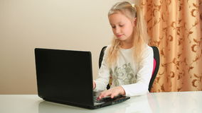 Girl typing on laptop computer. And sitting on chair stock video footage