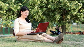 Girl typing on laptop Stock Photos
