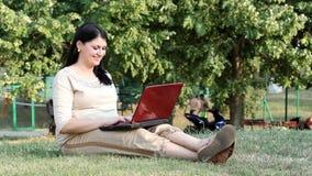 Girl typing on laptop Stock Photos