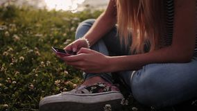 Girl typing a message on phone. HD stock video footage