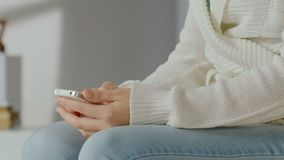 Girl typing message on smartphone, chatting online, close-up of woman's hand. Stock footage stock footage