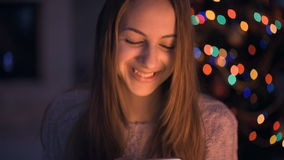 Girl typing a message on smartphone. stock footage