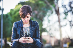 Girl Typing on Mobile Phone Stock Image
