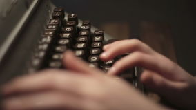 Girl typing on an old typewriter stock footage