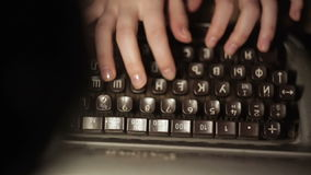 Girl typing on an old typewriter. Close up stock footage