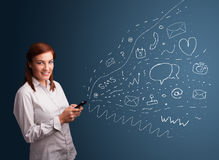 Girl typing on smartphone with various modern technology icons Stock Photography