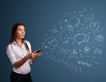 Girl typing on smartphone with various modern technology icons Royalty Free Stock Images
