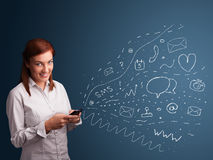 Girl typing on smartphone with various modern technology icons Royalty Free Stock Photography