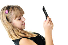 Girl typing sms. Teenage girl typing sms on the mobile phone over the white royalty free stock image