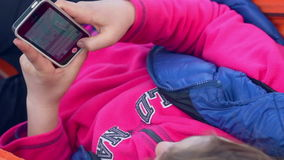 Girl typing text on mobile phone. Woman texting on smart phone. Top view stock video footage