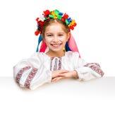 Girl in  Ukrainian  costume behind white board Stock Image
