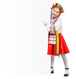 Girl in  Ukrainian  costume behind white board Stock Image