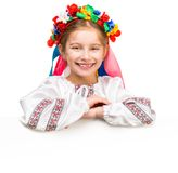 Girl in  Ukrainian  costume behind white board Royalty Free Stock Images