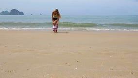 Girl in Ukrainian costume embroidery on beach. Little girl in the national Ukrainian costume embroidery walking on the beach stock video